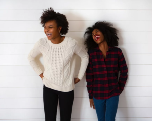Two women laughing, from Veguary page at afrovegansociety.org.